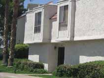 Repainting and repairs of older stucco condominium.
